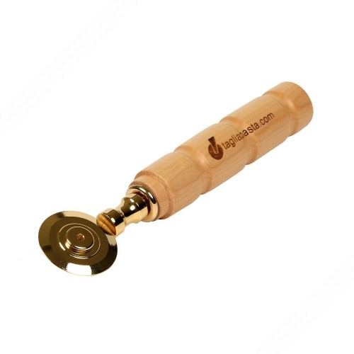 Golden brass pasta cutter with single smooth blade. Maple wood handle