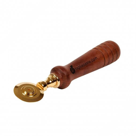 Golden brass pasta cutter with single smooth blade. Amaranth wood handle