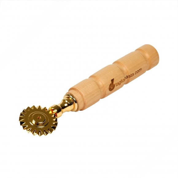Golden brass pasta cutter with single toothed blade. Maple wood handle