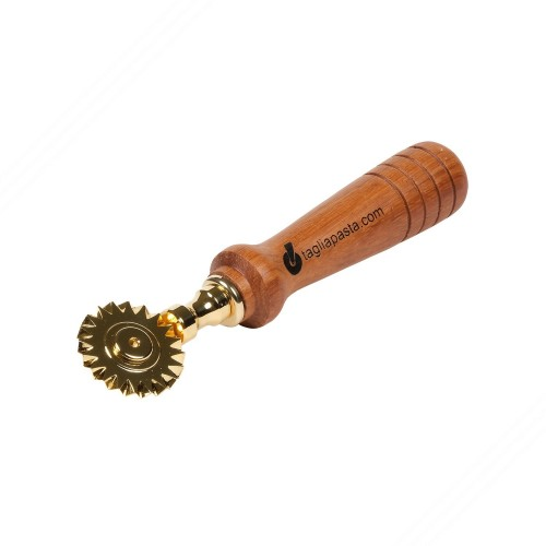 Golden brass pasta cutter with single toothed blade. Doussé wood handle