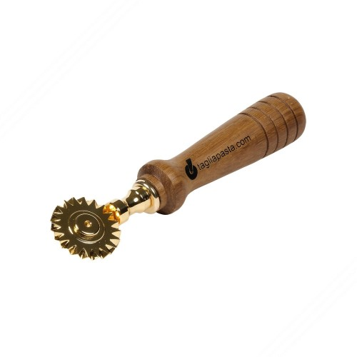Golden brass pasta cutter with single toothed blade. Teak wood handle