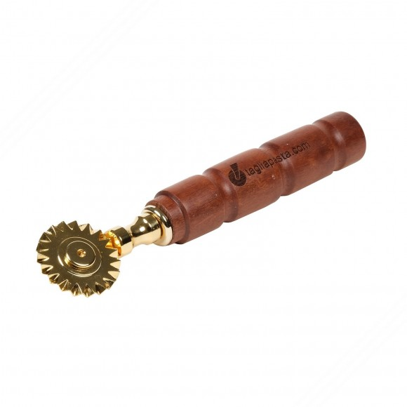 Golden brass pasta cutter with single toothed blade. Amaranth wood handle