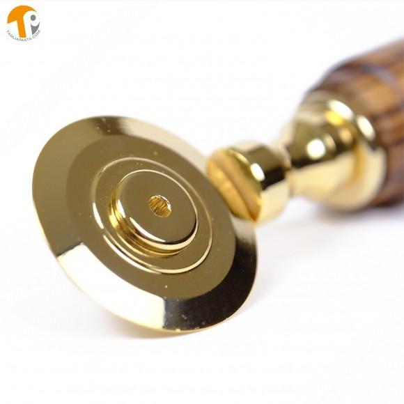Golden brass pasta cutter with single smooth blade. Teak wood handle