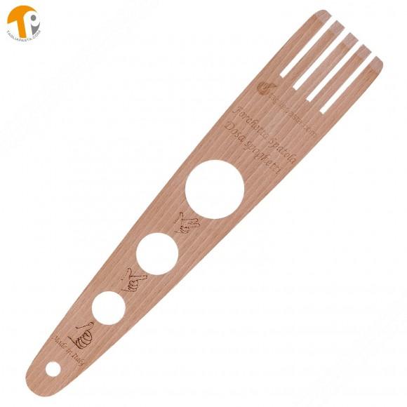 Attrezzo con 3 funzioni: spatola, forchettone e dosa spaghetti